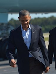 US President Barack Obama walks across the tarmac to greet supporters on October 13, upon arrival at Newport News/ Williamsburg International Airport in Williamsburg, Virginia