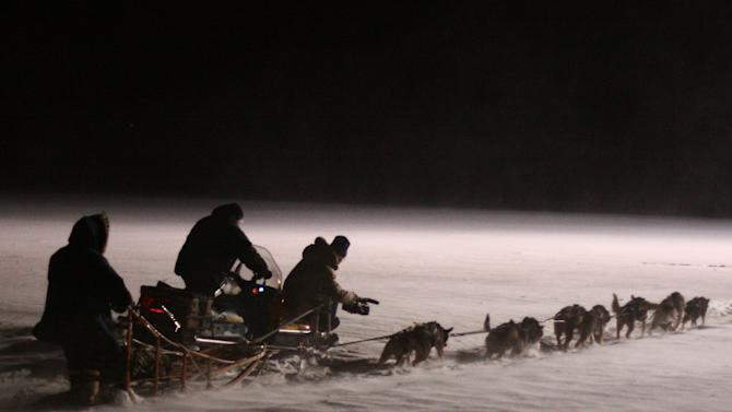 "In this March 2010 photo provided by Anker Productions, a film crew follows a dog team during the making of the documentary ""Icebound,"" in Nenana, Alaska. The movie detailing a 1925 delivery of life-saving serum by Alaska sled dog relay teams is opening the Anchorage International Film Festival on Friday Dec. 6, 2013. The 5 ½-day run to Nome after a diphtheria breakout was done by New York filmmaker Daniel Anker. (AP Photo/Anker Productions, Daniel Anker)"