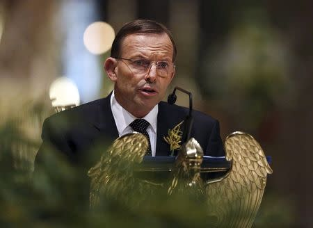 Australian Prime Minister Tony Abbott delivers remarks during a national memorial service in Melbourne