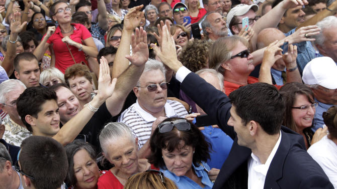 Rep. Paul Ryan, R-Wis., newly announced Republican vice presidential candidate to Republican presidential candidate, former Massachusetts Gov. Mitt Romney, high-fives people in the crowd after speaking at a campaign event Saturday, Aug. 11, 2012, in Norfolk, Va.  (AP Photo/Mary Altaffer)