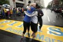 Rachel, left, and Pam Vingsness of Newton, Mass., hug each other after crossing the finish line as runners who were unable to finish the Boston Marathon on April 15 because of the bombings were allowed to finish the last mile of the race in Boston, Saturday, May 25, 2013. (AP Photo/Winslow Townson)