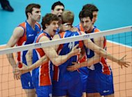 Serbian players react after getting a point against Iran in the men's volleyball qualifying tournament for the London Olympics, in Tokyo, on June 9. Serbia qualified following their 30-28, 30-28, 25-22 win