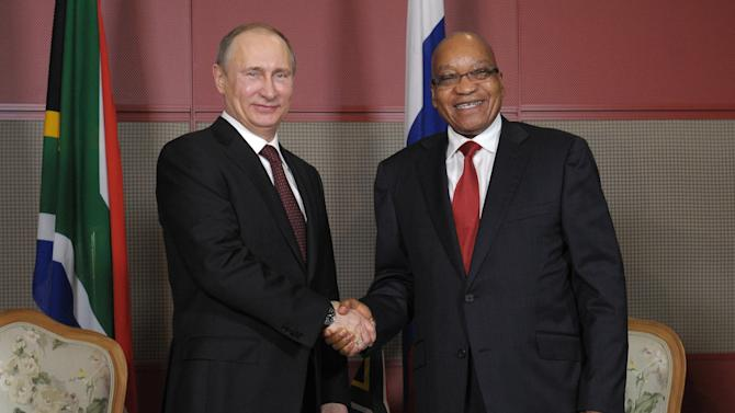 South African President Jacob Zuma and Russian President Vladimir Putin shake hands during their meeting in Durban, South Africa, Tuesday, March 26, 2013. Leaders of Brazil, Russia, India, China and South Africa _ the five countries that the World Bank says are driving global economic growth _ arrived in South Africa's coastal resort of Durban for a two-day summit to start Tuesday evening. (AP Photo/RIA-Novosti, Alexei Druzhinin, Presidential  Press Service)