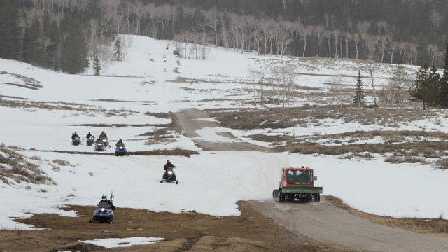This image provided by the Emery County Sheriff's Office shows officials transporting fugitive Troy James Knapp into custody Tuesday April 2, 2013, in mountains outside of Ferron in central Utah. Authorities captured the elusive survivalist on Tuesday who is suspected of burglarizing Utah cabins and leaving some covered with threats and bullet holes — ending a saga that began six years ago. (AP Photo/Emery County Sheriff's Office)