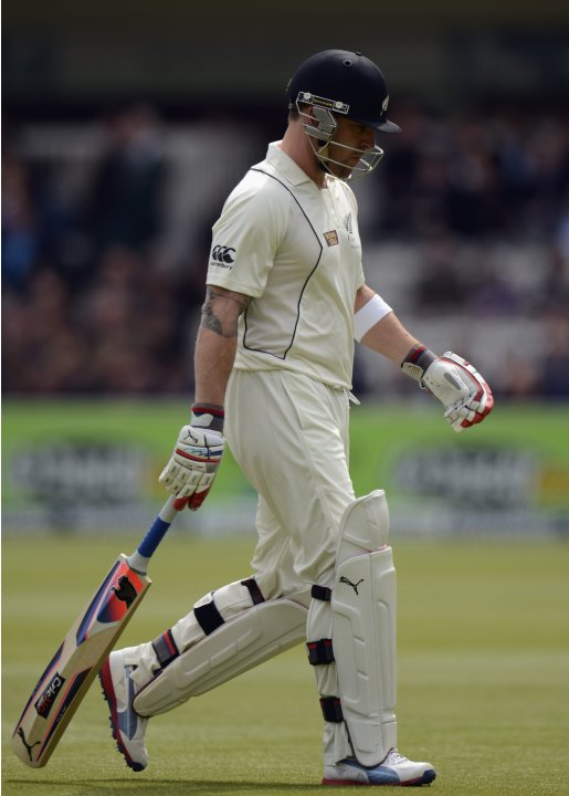 New Zealand's McCullum leaves the field after being dismissed during the first test cricket match against England at Lord's cricket ground in London