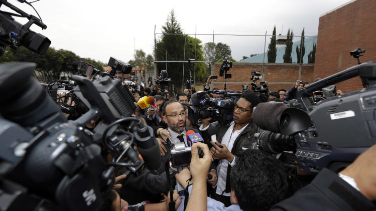 "Agustin Acosta, center left, lawyer of the imprisoned Frenchwoman Florence Cassez, speaks to reporters outside the prison where she had been held in Mexico City, Wednesday, Jan. 23, 2013. A Mexican Supreme Court panel voted Wednesday to release Cassez, a Frenchwoman who says she was unjustly sentenced to 60 years in prison for kidnapping and whose case became a cause celebre in France, straining relations between the two countries. A police convoy with sirens flashing escorted a white sports utility vehicle out of the prison where Cassez had been held later Wednesday, presumably carrying her to the Mexico City airport. Relatives of kidnap victims angrily shouted ""Killer!"" as the vehicle pulled away. (AP Photo/Andres Leighton)"