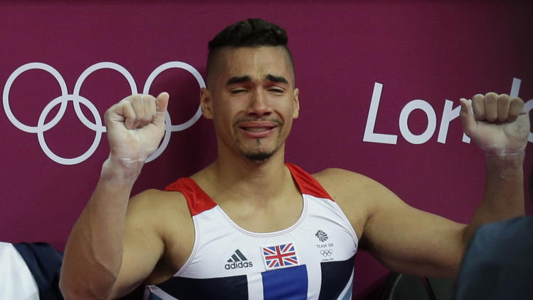 Great Britain's gymnast Louis Smith clenches his fists and cries during the Artistic Gymnastics men's qualification at the  2012 Summer Olympics, Saturday, July 28, 2012, in London. (AP Photo/Gregory Bull)