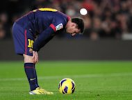 Barcelona's Argentinian forward Lionel Messi concentrates prior to a penalty kick at the Camp Nou stadium in Barcelona on January 6, 2013. Messi may owe his trademark feints and body swerves to the fact his brain is busier than that of a less gifted player, according to a study into a footballers' minds