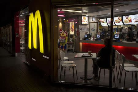 A customer is seen through the windows of a McDonald's store in Hong Kong