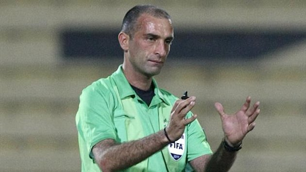 Referee Ali Sabbagh (Reuters)