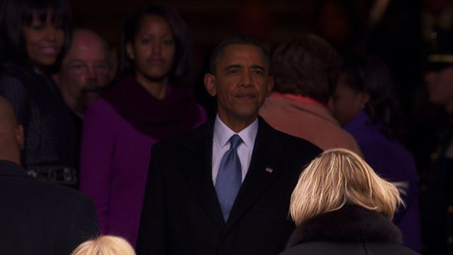 Obama takes in inauguration crowd