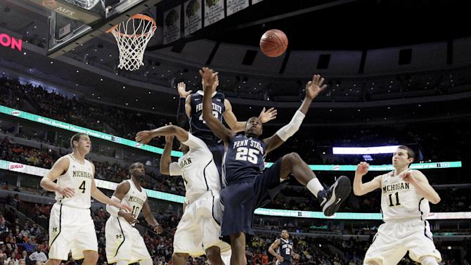 Michigan's Glenn Robinson III (1) and Penn State's Jon Graham (25) and Ross Travis (43) battle for a rebound during the first half of an NCAA college basketball game at the Big Ten tournament Thursday, March 14, 2013, in Chicago. (AP Photo/Nam Y. Huh)