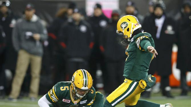 Edmonton Eskimos place kicker Whyte misses a field goal as teammate Lynch holds in the third quarter against the Ottawa Redblacks during the CFL's 103rd Grey Cup championship football game in Winnipeg