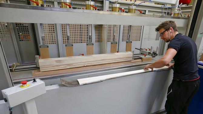 An employee prepares a wooden layer of a ski at the plant of Swiss ski manufacturer Stoeckli in Malters