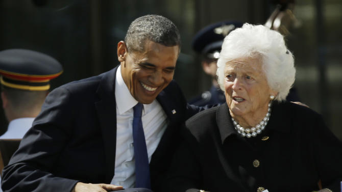 President Barack Obama laughs with former first lady Barbara Bush during the dedication of the George W. Bush Presidential Center Thursday, April 25, 2013, in Dallas. (AP Photo/David J. Phillip)