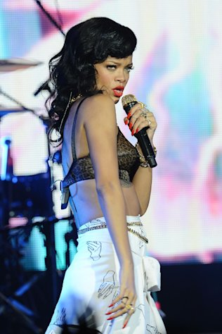 FILE - This Nov. 19, 2012 file photo shows Rihanna performing at the Kentish Town Forum in London. Sting, Rihanna and Bruno Mars will hit the stage for a special performance at next week's Grammy Awards. The Recording Academy announced Monday, Feb. 4, 2013, that they will perform together at the Feb. 10 awards show. Triple nominee Kelly Clarkson will also take the stage. (Photo by Jon Furniss/Invision/AP, file)