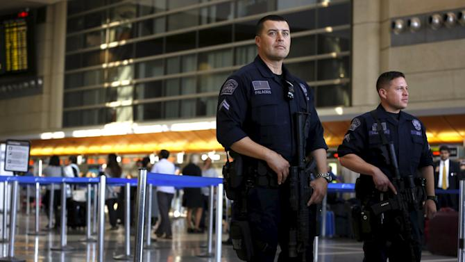 Los Angeles Airport Police officers keep watch inside Tom Bradley international terminal at Los Angeles Airport in Los Angeles