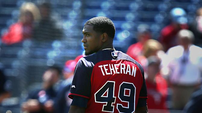 Atlanta Braves starting pitcher Julio Teheran (49) walks off the field after warmups before the start of a baseball game against the Philadelphia Phillies on Sunday, April 26, 2015, in Philadelphia. (AP Photo/Laurence Kesterson)
