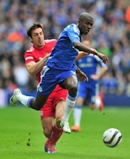 Chelsea's Ramires (R) evades the challenge of Liverpool's Jose Enrique on his way to scoring the opening goal in their FA Cup final match at Wembley Stadium in London. Chelsea won 2-1