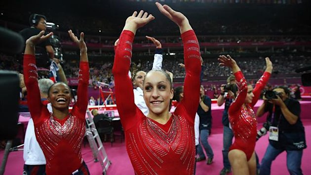 Jordyn Wieber (C) of the U.S. and team mate Gabrielle Douglas (L) celebrate after the women&#39;s gymnastics team final in the North Greenwich Arena at the London 2012 Olympic Games (Reuters)