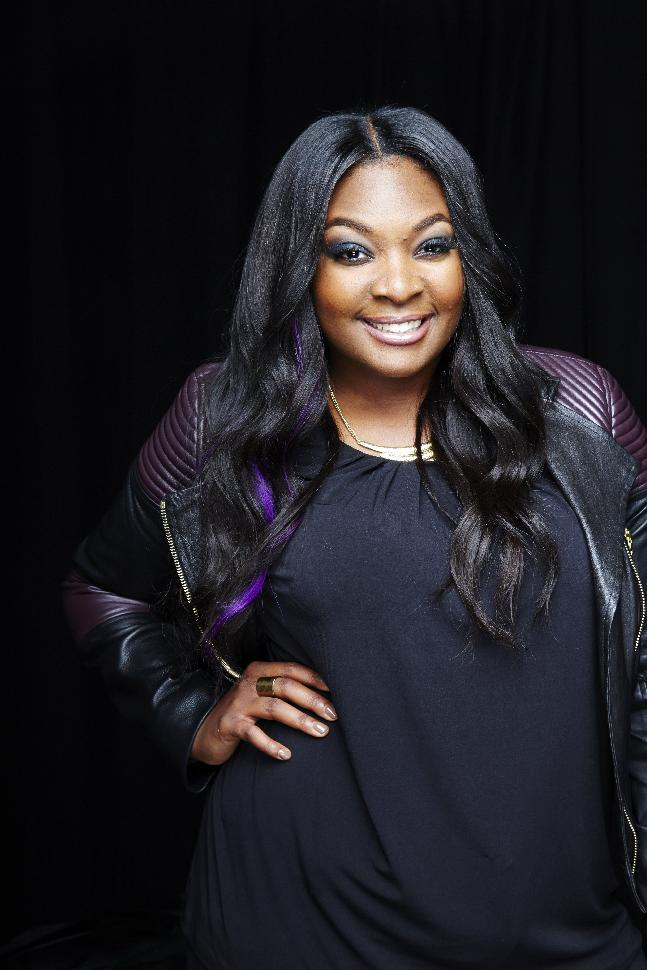 "This May 20, 2013 photo shows Candice Glover posing for a portrait in New York. Glover is the latest winner on the singing competition series, ""American Idol."" (Photo by Dan Hallman/Invision/AP)"