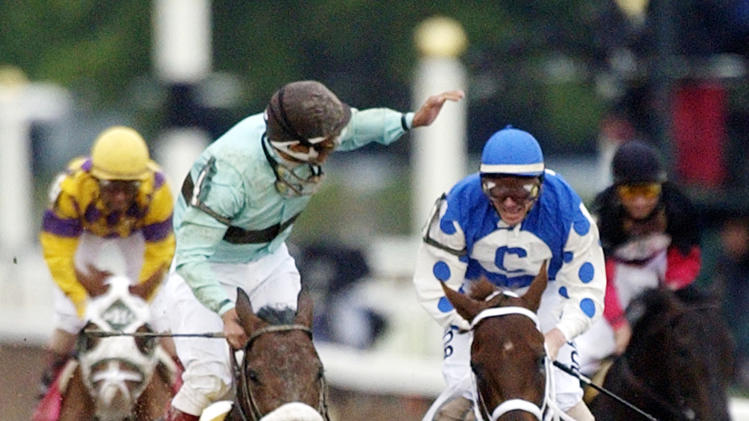 FILE - In this June 5, 2004, file photo, jockey Edgar S. Prado, left, aboard Birdstone, reacts after winning the Belmont Stakes horse race as jockey Stewart Elliott, right, aboard Smarty Jones, watches at Belmont Park in Elmont, N.Y. Early duels with Rock Hard Ten and Eddington along the backstretch proved to be Smarty's undoing, as the horse would go on to tire in the stretch and be caught in the final 70 yards by 36-1 long shot Birdstone. As I'll Have Another prepares to attempt to win the Belmont Stakes in his quest to become the 12th Triple Crown champion and first in 34 years on Saturday, June 9, 2012, The Associated Press takes a look at some of the 19 horses who won the Kentucky Derby and the Preakness, but came up short in the final leg of the Triple Crown, and how the race unfolded. (AP Photo/Frank Franklin II, File)