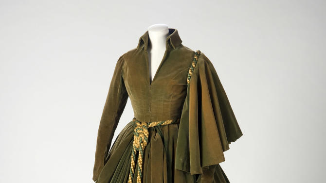 """This undated photo provided by the Harry Ransom Center shows the conserved green curtain dress worn by Vivien Leigh as Scarlett O'Hara in """"Gone With The Wind"""". The iconic dress and Scarlett's burgundy ball gown from the 1939 film were saved from deterioration by a $30,000 conservation effort by the Harry Ransom Center at the University of Texas, and are on display for the first time in nearly 30 years at London's Victoria and Albert Museum as part of a Hollywood costume exhibit. (AP Photo/Harry Ransom Center,Pete Smith)"""