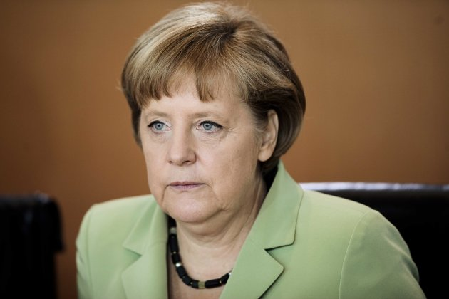 German Chancellor Angela Merkel reacts as she arrives for the weekly cabinet meeting at the chancellery in Berlin, Germany, Wednesday, June 6, 2012. (AP Photo/Markus Schreiber)