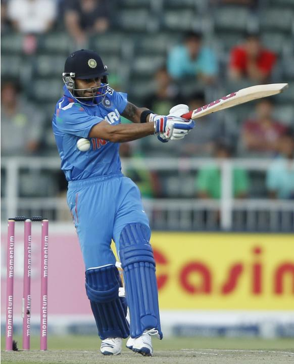 India's Sharma is hit by South Africa's Morkel delivery during their first ODI in Johannesburg