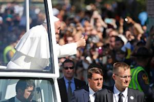 Pope Francis greets the crowd on September 23, 2015,…