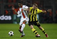 Borussia Dortmund's Marcel Schmelzer tackles Shakhtar Donetsk's Douglas Costa (L) during the Champions League soccer match in Dortmund March 5, 2013. REUTERS/Ina Fassbender