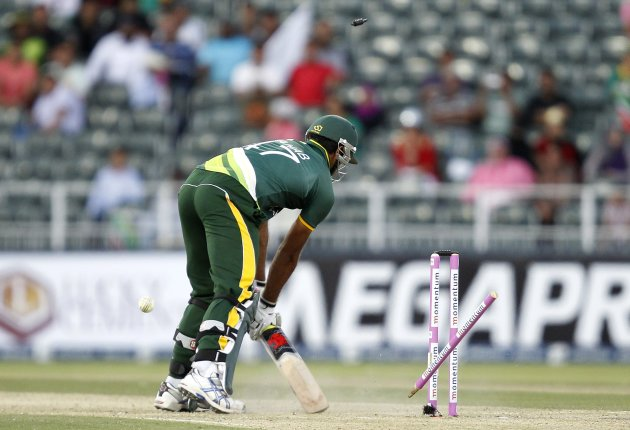 Pakistan's Wahab Riaz is bowled out by South Africa's Rory Kleinveldt during their third ODI cricket match in Johannesburg