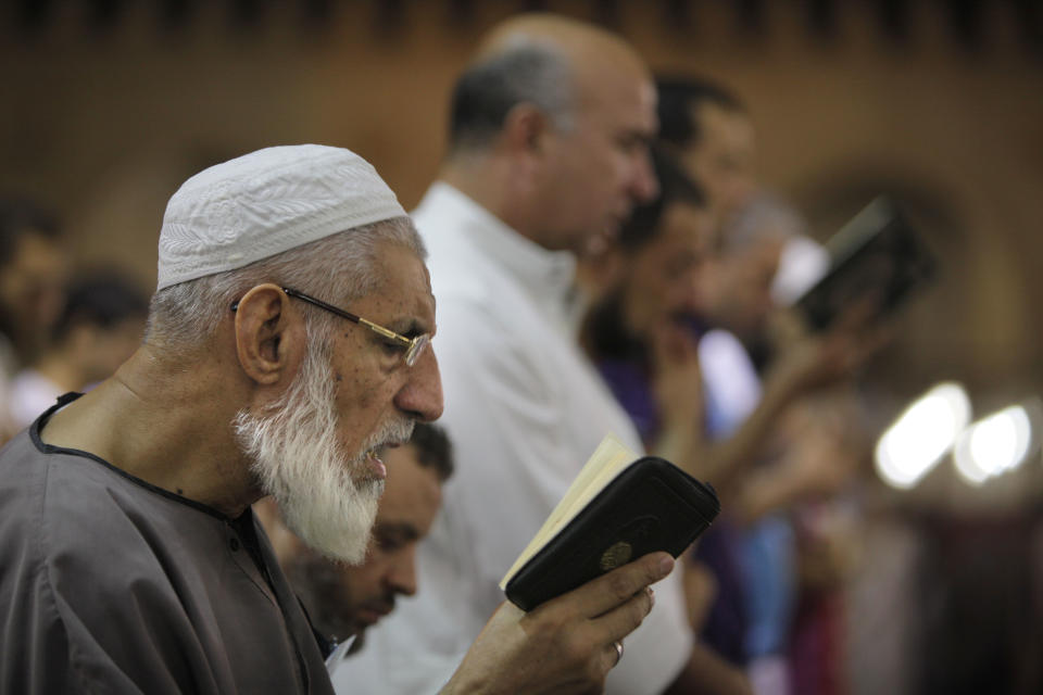 Egyptian Muslims pray special prayers marking Laylat al-Qadr, Night of Power, at Amr Ibn Al-As mosque in Cairo, Egypt, early Wednesday, Aug. 15, 2012. Muslims Seek Laylat al-Qadr in the odd nights during the last ten nights of Ramadan. (AP Photo/Amr Nabil)
