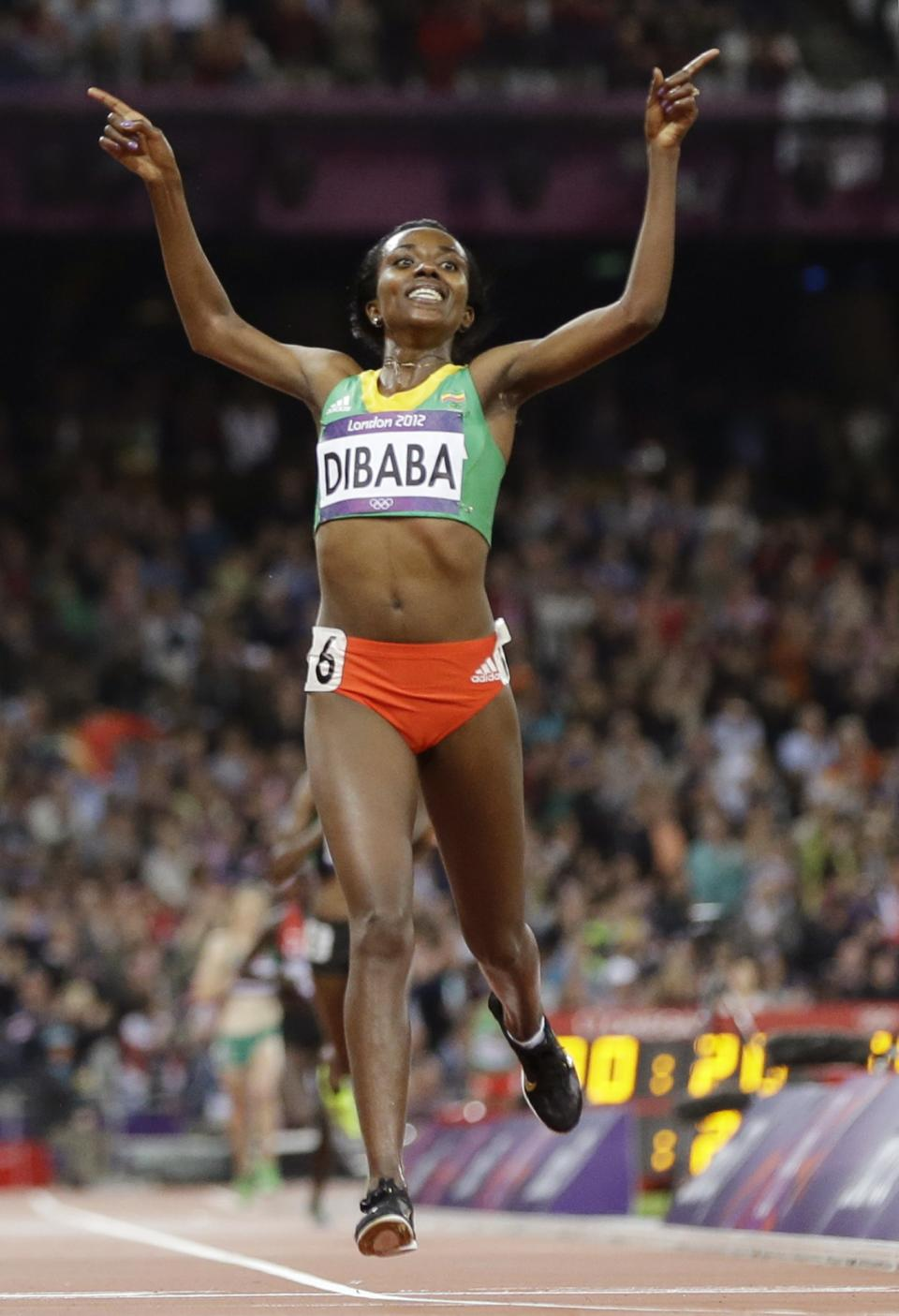Ethiopia's Tirunesh Dibaba crosses the finish line to win gold in the women's 10,000-meter final during the athletics in the Olympic Stadium at the 2012 Summer Olympics, London, Friday, Aug. 3, 2012. (AP Photo/Anja Niedringhaus)