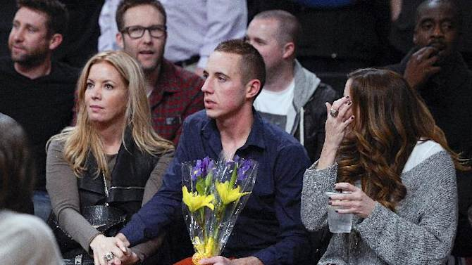 Los Angeles Lakers executive vice president Jeanie Buss, left, watches with friends and family during a memorial for her late father and team owner Jerry Buss before an NBA basketball game between the Lakers and the Boston Celtics, Wednesday, Feb. 20, 2013, in Los Angeles. Jerry Buss died Monday after a battle with cancer. (AP Photo/Mark J. Terrill)
