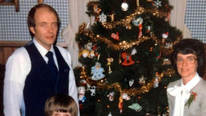 This circa 1980 photo provided by Mary Linnerooth Gonzalez shows the Linnerooth family, father, David, mother, Gayle, Pete and Mary next to their Christmas tree at their home in Rochester, Minn. Gayle, who adopted Pete when he was 9½ weeks old, recalls a loving little boy who adored animals, talked up a storm at 18 months old and was very sensitive. (AP Photo/Mary Linnerooth Gonzalez)