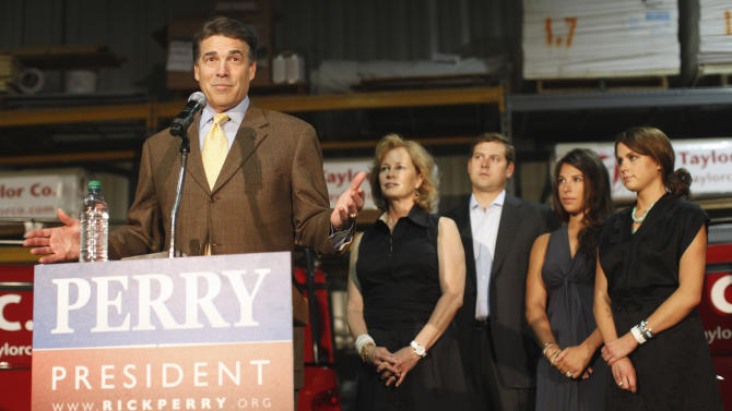 Republican presidential candidate, Texas Gov. Rick Perry speaks to workers as he makes a campaign stop at  D.C. Taylor Roofing in Cedar Rapids, Iowa,Tuesday, Aug. 16, 2011. From second from left are: wife Anita Perry; son Griffin Perry; daughter-in-law Meredith Perry; daughter Sydney Perry. (AP Photo/Charles Dharapak)