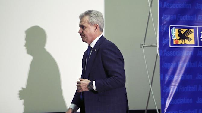 Japan national soccer team manager Javier Aguirre leaves after a press conference at the Japan Football Association headquarters in Tokyo, Saturday, Dec. 27, 2014. Aguirre said he will be focusing on preparing for the Asian Cup next month, despite a probe in Spain into allegations he was involved in match-fixing. (AP Photo/Koji Sasahara)