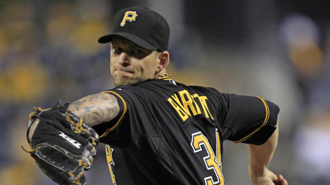 Pittsburgh Pirates starting pitcher A.J. Burnett (34) delivers during the first inning of a baseball game against the Cincinnati Reds in Pittsburgh Friday, Sept. 28, 2012.(AP Photo/Gene J. Puskar)