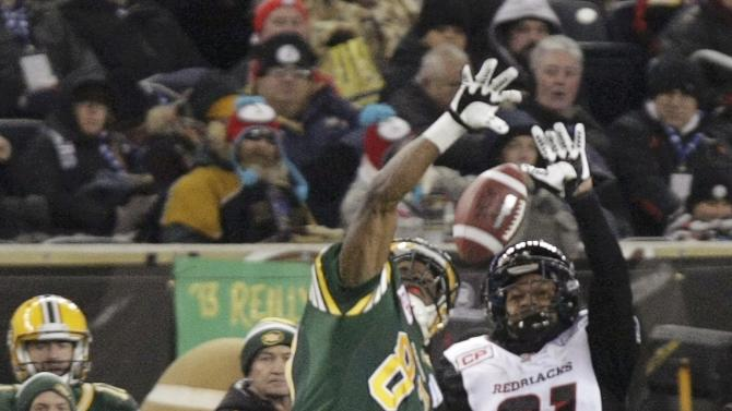 Edmonton Eskimos' Walker and Ottawa Redblacks' Sermons battle for an incomplete pass during the second half of the CFL's 103rd Grey Cup championship football game in Winnipeg