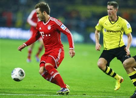 Bayern Munich's Goetze is challenged by Borussia Dortmund's Reus during their German first division Bundesliga soccer match in Dortmund