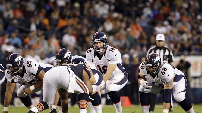 Denver Broncos quarterback Peyton Manning (18) calls a play from the line of scrimmage behind guards Manny Ramirez (65) and Zane Beadles (68) against the Chicago Bears during an NFL preseason football game in Chicago, Thursday, Aug. 9, 2012. (AP Photo/Nam Y. Huh)