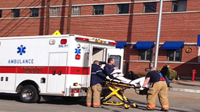 This image from video provided by KMOV-TV in St. Louis shows an injured worker being wheeled to an ambulance outside the American Steel plant in Granite City, Ill., Thursday, March 7, 2013, where an explosion injured at least 10 people, three critically. (AP Photo/Courtesy KMOV-TV in St. Louis) TELEVISION OUT