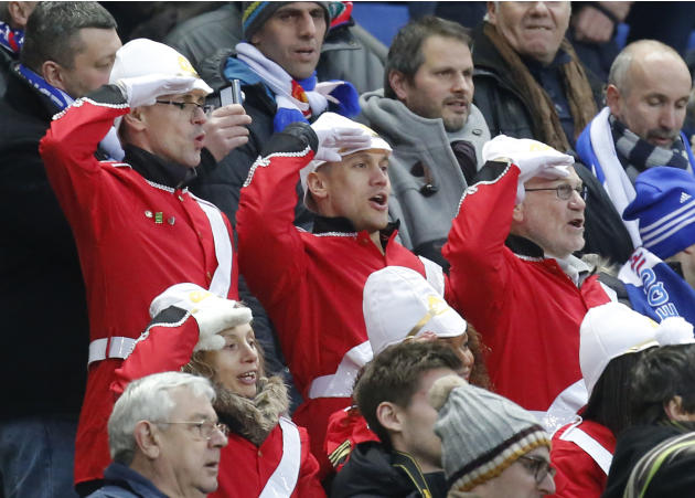 England's supporters salut during the the British National anthem prior to a Six Nations international rugby union match between France and England at Stade de France stadium in Saint Denis, near