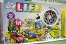"In this Wednesday, Nov. 11, 2015 photo, the Hasbro board game ""The Game of Life"" rests on a shelf in a toy store in North Attleboro, Mass. The widow of the toy inventor is suing Hasbro and another inventor in federal court, claiming they worked together to cut her out of millions in royalties. The game has sold more than 30 million copies. (AP Photo/Steven Senne)"
