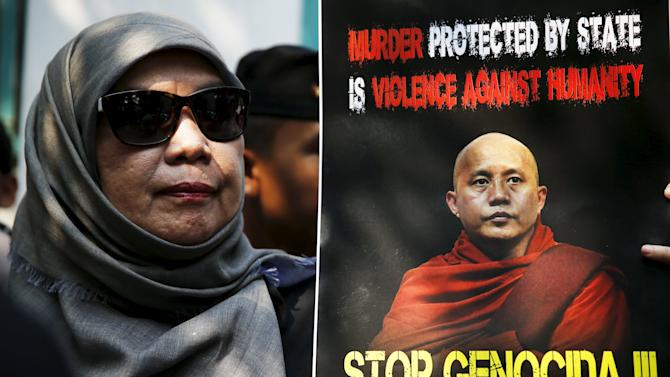 An Indonesian muslim student holds a poster of Myanmar Buddhist monk Ashin Wirathu during a protest against Wirathu as police stand guard in front of the Myanmar embassy in Jakarta