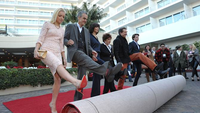 Miss Golden Globe Francesca Eastwood, from left, Dick Clark Productions CEO Allen Shapiro, Dick Clark Productions President Orly Adelson, HFPA President Aida Takla-O'Reilly, producer Barry Adelman, and Mr. Golden Globe Sam Michael Fox roll out the red carpet at the Golden Globe Awards preview day at the Beverly Hilton Hotel on Friday, Jan. 11, 2013, in Beverly Hills, Calif. (Photo by John Shearer/Invision/AP)