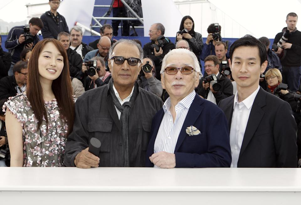 From left actress Rin Takanashi, director Abbas Kiarostami, actors Tadashi Okuno and Ryo Kase pose during a photo call for Like Somone in Love at the 65th international film festival, in Cannes, southern France, Monday, May 21, 2012. (AP Photo/Lionel Cironneau)