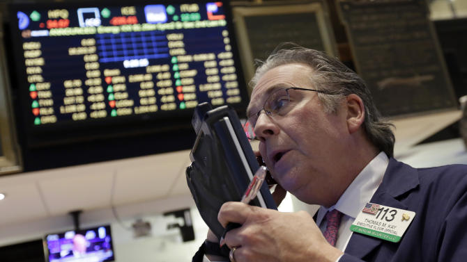 Trader Thomas Kay works on the floor of the New York Stock Exchange Wednesday, March 4, 2015. U.S. stocks are opening lower, putting the market on track for a second day of losses. (AP Photo/Richard Drew)