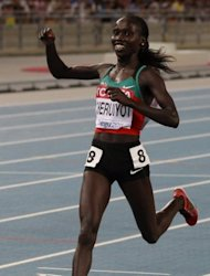Kenya's Vivian Cheruiyot celebrates victory in the women's 5000m event at the IAAF World Championships in Daegu in September 2011